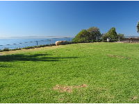 Bright lawn over the ocean at Lookout Park.