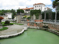 Garden layers: green pool, walled secret garden, and mansion.