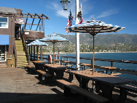 Shaded picnic tables on the pier where you can enjoy your icecream cone! The upstairs balcony that is open to the public is shown in the background.