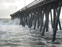 Waves crash below the pier! The pier is an exciting place to be during a swell!
