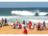 Spectators checking out the surf contest at Pipeline. A fun place to hang out and people watch in between waves.