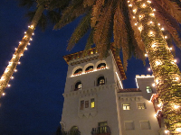 Casa Monica and palm trees, at Christmas time.