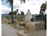 Rock boulders to climb on, and the adobe village in the distance.