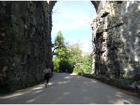 A runner approaches a rock archway.