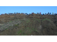 The vertical cliffs of mud, where trusting folks gather to get a better view of the waves.