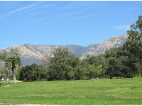 The mission gardens, lawn, and mountains.