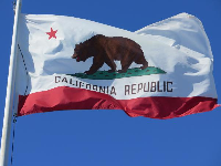 California flag at the end of the breakwater.