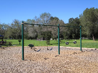 The playground with swings, bouncy, and baby swings.