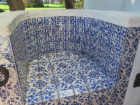 Blue tiled bench.
