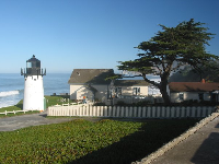 The Point Montara Lighthouse, and youth hostel, shaded by a Monterey cypress.
