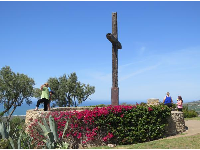 The cross, bougainvillea, and lookout.