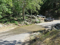 The trailhead is here, where the stream crosses the road (dry in summer and fall).