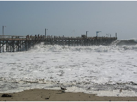 """Pier closed"" day during wintry surf at Goleta Beach."