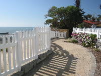Oceanfront white picket fence and pathway between Placentia Avenue and Boeker Avenue.