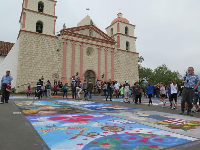 Colorful chalk paintings in front of the mission during the I Madonnari festival.
