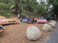 Boulders and picnic tables.