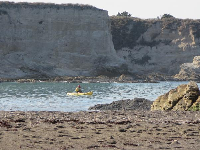 Kayaker and the impressive cliffs.