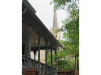 Beautiful southern porch with church in distance.