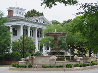 Fountain and mansion.