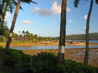 You can walk along the sand from Kuliouou Beach Park and see this view of the Canoe Club shack across the water.