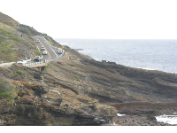 The road hugs the cliffs.