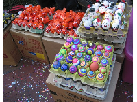 Beautiful confetti-filled eggs sold on the street during Fiesta week.