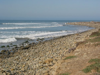 The west end of the beach, near the point, where the beach is entirely made up of large pebbles.