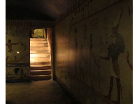 Egyptian wall paintings inside the tomb replica.