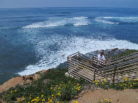 Climbing the beach-access stairs at Sunset Cliffs Natural Park.