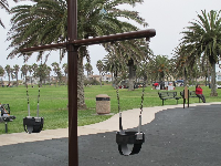 Baby swings and benches for parents.
