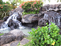 Great fountains and statues line Kalakaua Avenue by the Ocean Swimming Pool.