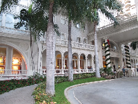 The Moana Surfrider's white columns and arches.