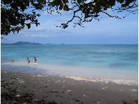 Kids swimming at the southern end of Waimanalo Beach.