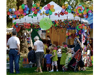 Stall selling rainbow-colored wind spinners in Alameda Park after the 2011 Summer Solstice parade. Photo by Arturo G. Vega.
