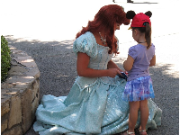 Meeting a princess near the Plaza Gardens Stage.