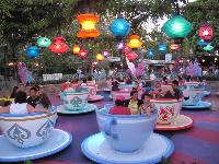 Fantasyland becomes pretty at night. Mad Teacups.