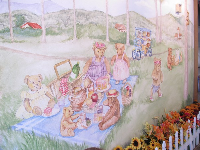 Tea room with mural of teddy bear picnic on lawn by Cabrillo Bike Path.