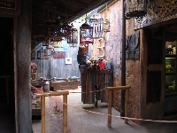Bird cages in an alley in the Asia area.
