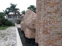 Looking past the sculpture with moat to the house.