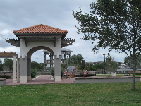 Riverfront park gazebos and splash pad area.
