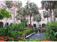 Palms and pond in the magical inner courtyard of the Lightner Museum.