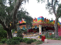 The colorful Musik Express ride amongst oak trees.