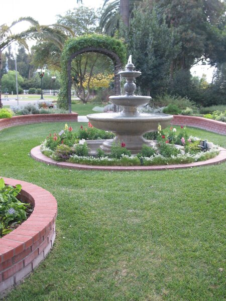 The Spanish fountain sits amidst Victorian brick-lined gardens.