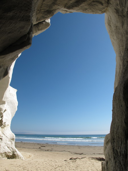 Looking through the cave's arch to the ocean.
