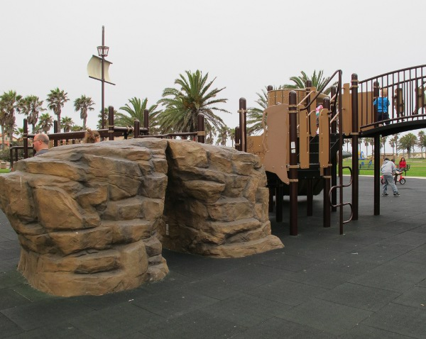 Rock climber and playground bridge with pirates on it.