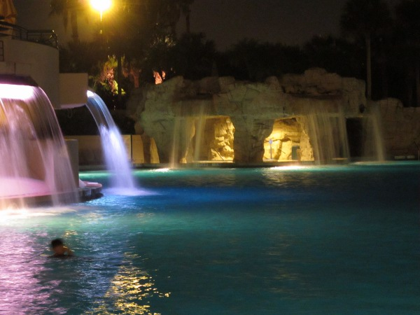 Waterfalls lit at night- a blissful swim!
