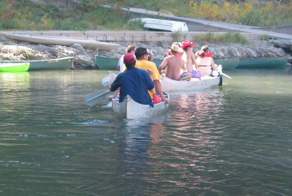 Groups of happy paddlers row down the river on weekends.