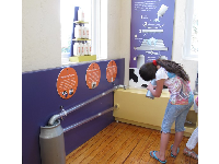 A girl learns about dairy farming.