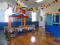 Upstairs room with boat and international flags.