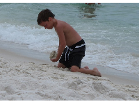 A boy plays in the sand.